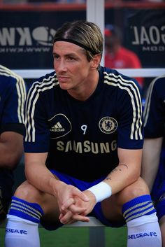 b19459383 Fernando Torres Photos Photos - Fernando Torres #9 of Chelsea sits on the  bench before
