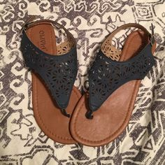 Olivia Miller sandals These sandals are great! They have only been worn once, as you can see by the condition of these sandals! There is a scuff mark on one of the sandals (pictured) but other than that, these are in great condition! Size 8. The color is a charcoal grey. Olivia Miller  Shoes Sandals