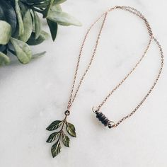 """A perfect accent to your wanderings, a pretty little raw brass leaf pendant hangs from a 26"""" chain. Magnetic closure. Pendant measures approximately 1.5"""" long"""