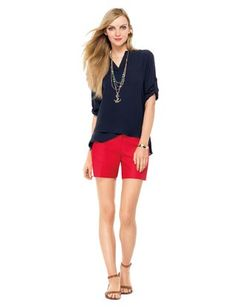 navy Vietnam blouse, coral shorts, black/brown sandals