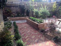 modern victorian garden brick walls herring bone brick path oak sleepers clapham dulwich london