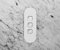 ZETR Trim-less Outlets & Switches. Three gang switch in matte white finishing flush in marble. Sage House, Glass House, Outlets, Wall Colors, Architecture Design, In This Moment, Marble, Maya, Furniture Design