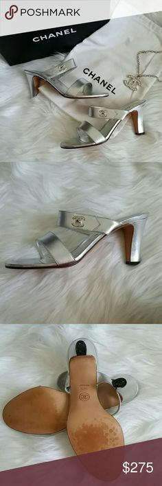 "Silver Chanel Heeled Sandals Beautiful lambskin silver leather heeled sandals. Heel measures 3"". Says 38 1/2 but fits like a US 7 1/2. Will include original box and dustbag. One of the heel tips has broken a little bit (picture 3) does not effect the way you walk in them and is an easy fix. Shoes are otherwise in great conditon. CHANEL Shoes Heels"