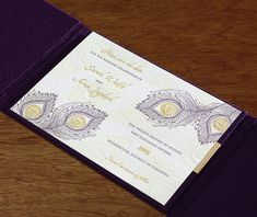 beautiful purple gold & blind letterpress peacock feather save the date in satin folio