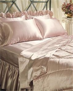 Luxurious custom made satin sheets shown here with matching satin comforter, pillowcases, shams, and dust ruffle.
