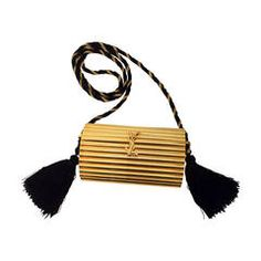 YSL Vintage Gold Metal Black Tassel Evening Bag / Clutch 1980s   From a collection of rare vintage handbags and purses at https://www.1stdibs.com/fashion/handbags-purses-bags/