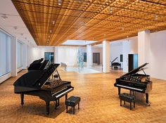 """""""Steinway Hall"""" the famous #Piano maker's showroom designed by Annabelle Selldrof, is located at the base of a high-rise building in Midtown #Manhattan, features wooden elements that reference the company's handcrafted pianos.  With an area of 1765 SQM, the piano showroom includes a retail area, a 74-seat recital hall, rehearsal space and a recording studio.  #decor #interiordesign #newyork #minimalism #nyc #luxury #interiorarchitecture #architecturelovers #interiordecor #ANNABELLESELLDROF…"""