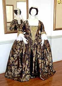 "18th century fashions-  This dramatic outfit began with a rich black and gold silk damask, in a large floral pattern of the 1740's, and is a closed robe, or ""Round"" gown.  A matched set of embroidered cuffs and stomacher, created in gold bullion, ribbons, sequins and trimmings are based on an original set (in silver) in the Snowshill collection, England. Gown is styled after a portrait of Mrs.Charles Willing, by Feke and decorations after a portrait of Lady Frances Byron, 1733, by…"