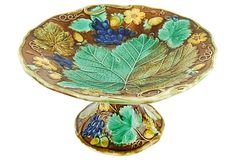 Antique Majolica Grapevine Pedestal on OneKingsLane.com. This is a style initiated by Wedgwood and used by Griffen Smith and Hill. This might be by a third manufacturer.