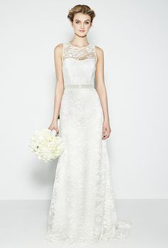 DESIGNER: Nicole Miller STYLE: Bettina IM10000 NECKLINE: Sweetheart Illusion SILHOUETTE: Sheath FABRIC: Two-tone Lace COLOR: Ivory FEATURES: Lace illusion neckline sheath gown, button details on back TRAIN: Chapel CONDITION: BRAND NEW! SIZE: 8 or 12 PRICE: $1,400.00