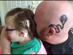 This Dad's Amazing Surgical Tattoos Are Helping His Daughter Feel Less Alone