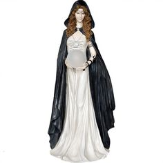This Enchantress of Light figurine by Nemesis Now is absolutely stunning. She has beautiful wavy hair and wears a head necklace, a long white gown and black hooded cloak. Standing at approx. 79cm high this witch figurine features a battery operated LED crystal ball that she holds in her hands. Made of resin with a hand painted finish.  Product Number: D0641B4