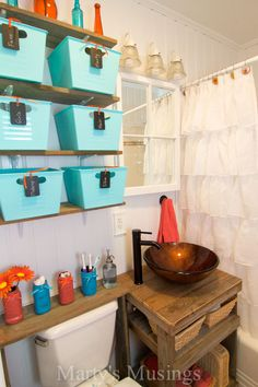Small Bathroom Remodel from Marty's Musings I like the over the toilet shelf and the baskets to hold unsightly items...easy organization