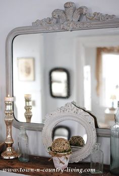 Mirror and glass vignette at Town and Country Living