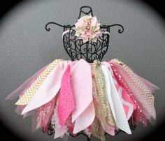How cute would your little one look sporting this gold and pink tutu!?!? It is handmade with a number of print cottons, lace, and tulle. This