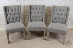 Lovely button back French style upholstered dining chair in stone linen. This chair also comes in cream.