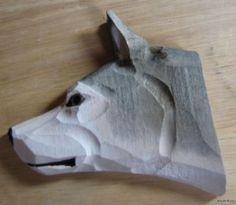 wood carving wolf head