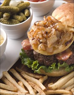 French Bistro Burgers with Caramelized Onions, Bacon and Brie:  A delicious, juicy burger with a hint of garlic and Herbes de Provence, creamy, gooey brie, crispy bacon and topped with caramelized onions that had been slow cooked until meltingly sweet.