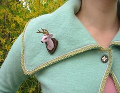 Deer brooch. Dear Brooch, I can't decide if you are creepy or charming or both. But I really like you. I think you'd look swell on my Christmas cardigan.