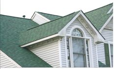 GAF ELK Hunter Green Shingles - this roof has some color but still looks very traditional.  We are a Minneapolis and St. Paul roofing company, and we are proud to install GAF/Elk roofing.  http://www.quarve.com