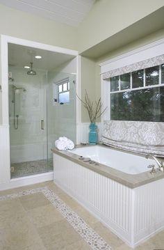 """Bali Cloud"" Pebble border on the bathroom floor to match the shower floor…"