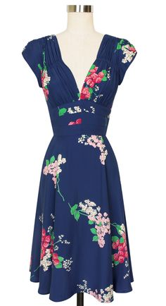 Featuring multi-tonal pink clover flowers and graceful ivory blooms on a navy base, the Crimson Clover print lends the signature 1940's Dress a perfectly flirty feel, making it an excellent pick for work or play!