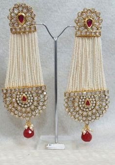 Jewelry has the power to be this one little thing that can make you feel unique. Beautiful Light Weight Earrings Light weight Pearl Kundan Long dangler Ethnic party wear Festival and wedding wear Only @ Rs. each Order today, call : 88988 89404 Western Earrings, Indian Jewelry Earrings, Jewelry Design Earrings, India Jewelry, Pearl Jewelry, Gold Jewelry, Jewelry Box, Stylish Jewelry, Fashion Jewelry