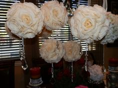 These would be cute hanging off the chairs along the aisle for the ceremony