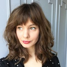 Medium Layered Haircut With Straight Bangs