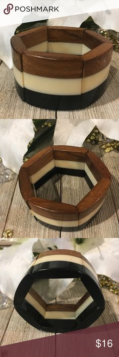 Chico's Wooden Stretch Bracelet! NWOT!! Very pretty Wooden tri color stretch bracelet from Chicos. Never been worn.  1 1/2 inches wide. Chico's Jewelry Bracelets