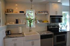 the granite gurus: holiday re-runs: before & after: super white quartzite kitchen