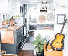 This couple lives on a blueberry farm in their bohemian-inspired RV! View the tour from @The_Ramblr_RV on MountainModernLife.com #rvrenovation #rvremodel #rvliving #tinyhome #camperremodel #camperrenovation #tinyhouseliving #designvibes #tinyhometour