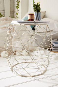 Geometric Metal Side Table - Urban Outfitters $69 // could be interesting as a pair topped with trays for coffee table seating