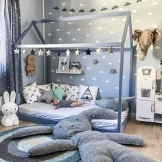 I love the simplicity of the bed frame. Looks like an easy DIY!