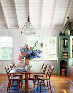 The dining room table in actor Tony Shaloub's home is made from the wood of a 1920s sailboat.     #diningrooms #decorating