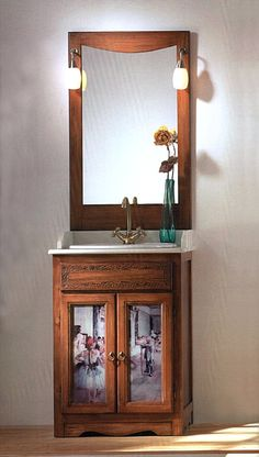 """Schmaler Waschtisch """"Degas"""" Nr. 01 - Ein extrem schmales Badmöbel aus der """"Belle Arti"""" Kollektion. Die Glasscheiben des Unterschranks sind mit einer Reproduktion des Gemäldes """"Die Tänzerinnen"""" des französischen Malers Edgar Degas hinterlegt."""