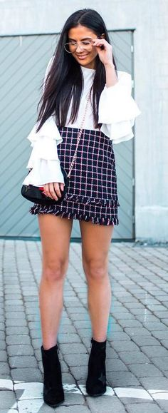 pretty cool outfit idea : white top   bag   plaid mini skirt   boots