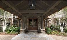 nice front porch /porte cochere entrance and landscaping