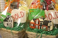 Did these for a friend who is a realtor.  She gives them to her clients when they close on a house.  The house cookies in the front are made to look like the house that was sold, and there is also a mailbox cookie in the basket (hard to see) with the buyer's name and house number.  There is also a sold sign, a welcome mat and 4 flower cookies.