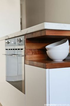 Adore this wooden insert shelf, but with plain white counter tops - no marble!