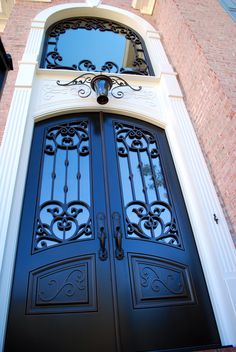 Double Front Entry Doors with Matching Transom Window - Versailles Panel Design - Finished in Weathered Bronze - Call us today!        678-894-1450 www.masterpiecedoors.com