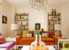 Jonathan Adler's NYC home with Jonathan Adler designed Meurice Chandelier, burnt orange sofa and pink armchair