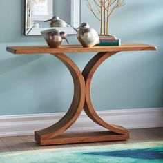 Our artful Bergen Console is as much a masterpiece of brilliant design as it is a stunning stage for books or a lamp. The simplicity of the opposing demi-circle shape means Bergen will look right at home in a variety of decorsSubstantially crafted for years of beautiful service from solid mahogany   Arrives assembled