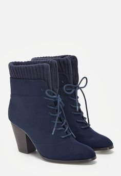 This faux suede bootie features a sweater cuff detail and lace up closure with a chunky block heel....