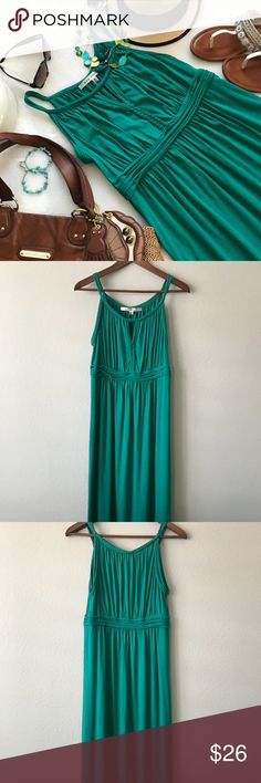 "Max Studio Green Tank Maxi Dress Size Medium In EUC!!  Pretty green maxi dress by Max Studio size medium. Tank top style. Pretty gathered look on the straps and waistline. Peek hole on the chest with cute braiding detail. Fabric is soft and stretchy. This is really a nice dress.   92% viscose 8% spandex   16"" Chest 14"" Waist 20"" Hip 49"" Length   Will ship 📦 from my smoke free home 🏠 Max Studio Dresses Maxi"