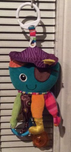"""Found on 15 Mar. 2016 @ Wandsworth Common / Bolingbroke Grove. Found on Sunday 13th March, on the diagonal path leading to the footbridge over the railway, from Bolingbroke Grove, a multi-coloured """"LAMAZE"""" octopus pram toy. I know it is not a """"cuddly"""" toy as s... Visit: https://whiteboomerang.com/lostteddy/msg/n9ylql (Posted by Marianne on 15 Mar. 2016)"""
