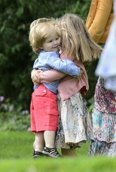 Princess Isabella tries to carry her baby brother Prince Vincent
