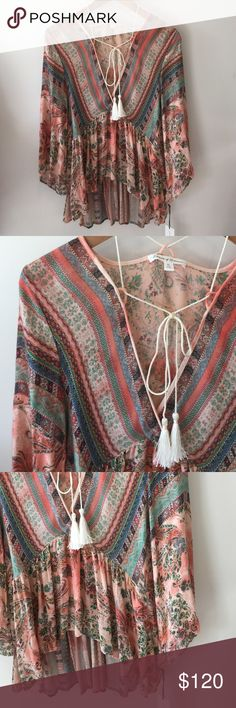 Flowers of romance tie up top Super soft paisley print. Never worn, tags. Brand: flowers of romance Free People Tops Blouses