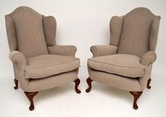 pair-of-antique-upholstered-wing-armchairs This pair of antique wing armchairs have just been completely re-upholstered with new feather cushions. They have generous proportions & are very comfortable. I love armchairs that you can put your head back on & always find wing armchairs the most comfortable of all armchairs. They have hump backs, shaped wings & scrolled out arms. The cushion are very generously filled with new feathers. These chairs have shaped Queen Anne style legs & the front…