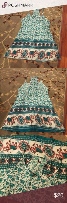 NWOT Teal elephant mini dress/tunic So adorable! Labeled as a large but this would best fit a small or xsmall!!! No stretch. Sadly it does not fit me! ?? zhou Dresses Mini